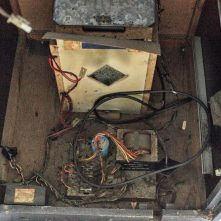 Power supply inside back of cabinet before cleaning